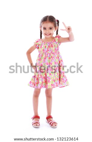 a beautiful and happiness girl showing a V for victory - stock photo