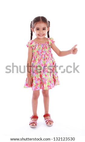 a beautiful and happiness girl showing thumbs up - stock photo