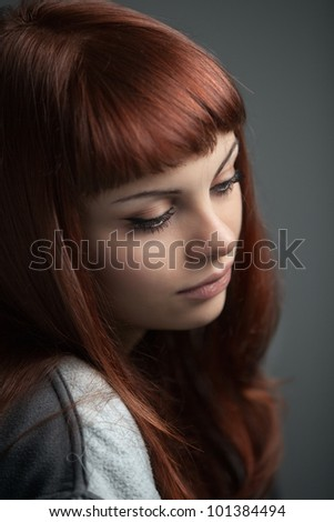 A beautiful and sensual young red haired girl posing. Shallow depth of field on model's eyes - stock photo