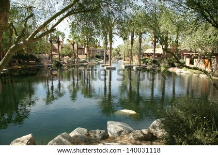 a beautiful and tranquil man made pond on a golf course - stock photo