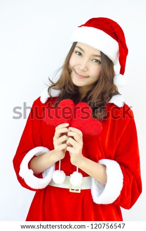 A Beautiful Asian santa woman in red cloth with red heart in her hand.