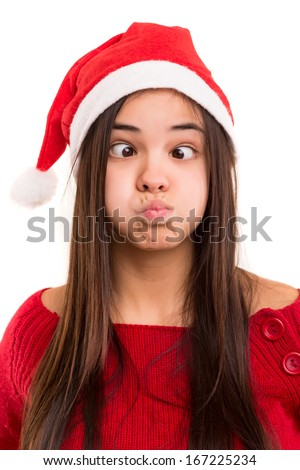 A beautiful asian woman with a christmas hat making a silly expression - stock photo