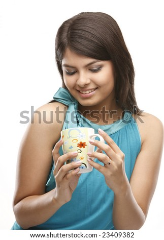 A beautiful Asian young woman holding a cup - stock photo