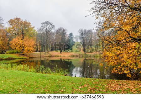A beautiful autumn landscape. City Park in Warsaw. Lazienki Krolewskie is a popular tourist place in the city center, Warsaw, Poland.