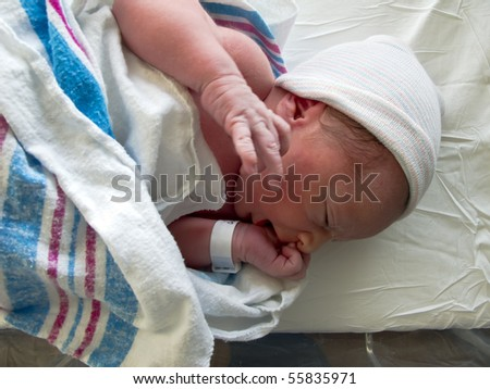 A beautiful baby photographed just after birth - stock photo
