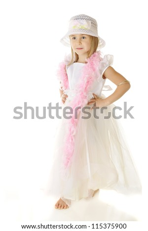 A beautiful, barefoot elementary girl dressed up all in white, with a long pink boa wrapped around her shoulders.  On a white background.