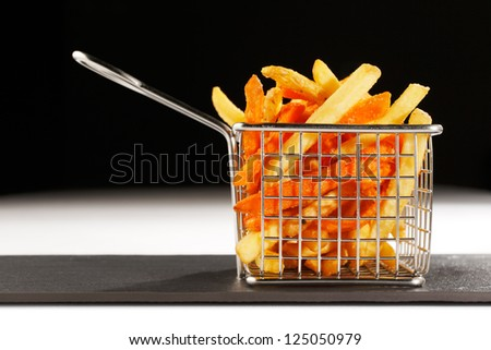 A beautiful basket of deep fried chips, also known as French Fries are more British than French