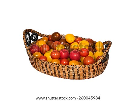 A beautiful basket of Heirloom Tomatoes. - stock photo