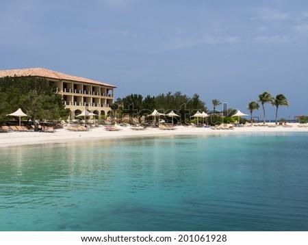 A beautiful beach and hotel on the Island of Curacao Caribbean  - stock photo