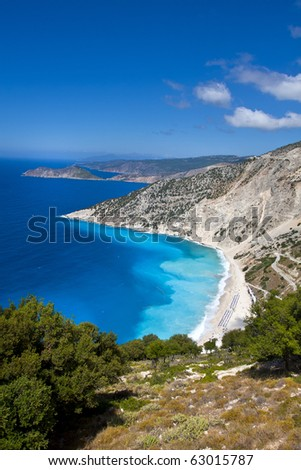 a beautiful beach - surrounded by mountains - blue water and fine sand - mythos beach kefalonia greece - stock photo
