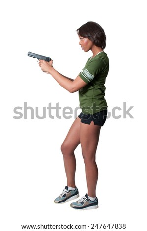 A beautiful black African American police detective woman on the job with a gun - stock photo