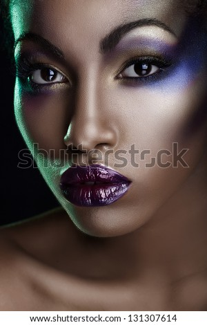 A beautiful black girl with make-up - stock photo