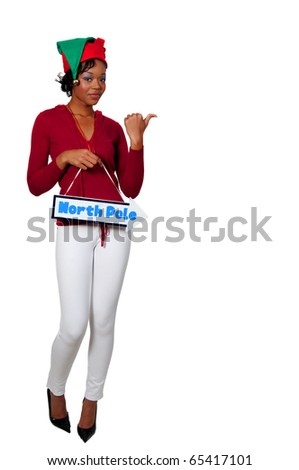 a beautiful black woman elf holding a north pole sign - stock photo