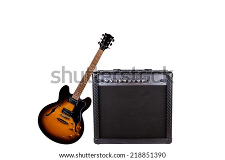 A Beautiful Black-Yellow Electric Guitar and an Amplifier Isolated on a White Background - stock photo