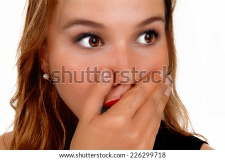 A beautiful blond young woman holding her hand for her mouth, she is shocked what she seeing, isolated for white background.  - stock photo