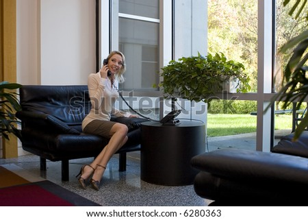 A beautiful blonde business woman in a modern office building