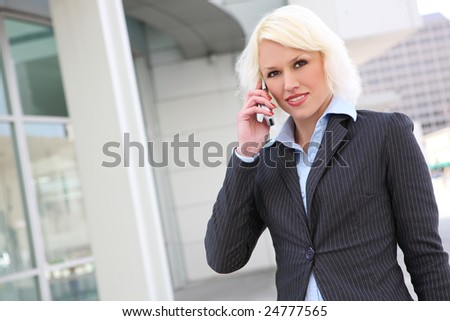 A beautiful blonde business woman on the phone at work