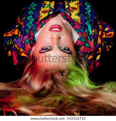 A beautiful blonde caucasian girl over black - stock photo