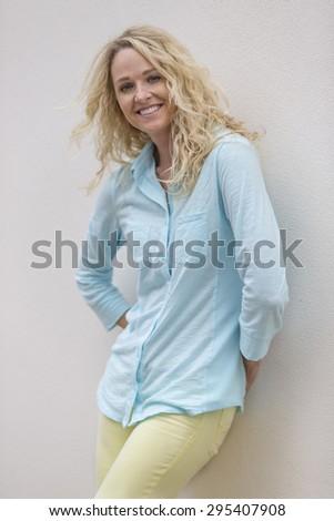 A beautiful blonde model posing outdoors  - stock photo