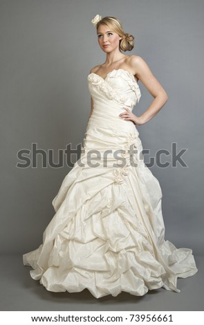 A beautiful blonde woman in a white wedding gown