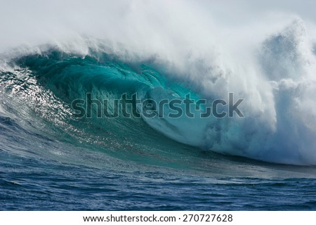 A beautiful blue wave crashes down at one of the world's premier big wave surfing spots, Dungeons in Cape Town, South Africa.