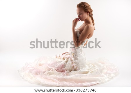 a beautiful bride in a dress on a white background