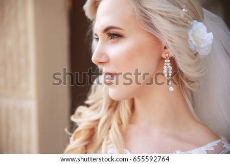 A beautiful bride looking to the side outdoors.