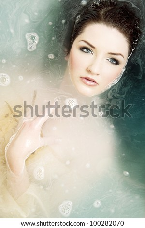 A beautiful brunette submerged in water - stock photo