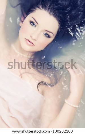 A beautiful brunette submerged in water