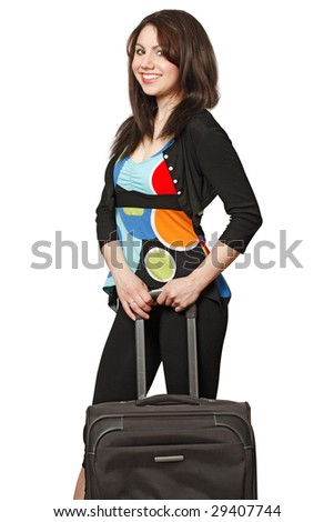 A beautiful brunette waiting to travel with a black suitcase.  Isolated on a white background. - stock photo