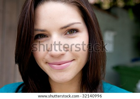 A Beautiful Brunette with fresh skin looking at camera
