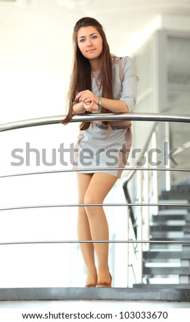 A beautiful business woman on stairs - stock photo