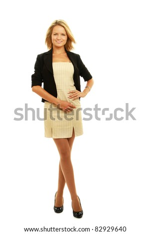 A beautiful business woman showing her happy expression standing isolated against white background