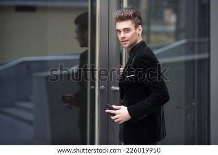 A beautiful businessman entering the office