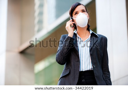 A beautiful businesswoman wearing a mask to represent the tough economic and world times