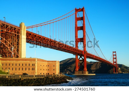A beautiful capture of the Golden Gate Bridge right at sunrise on a gorgeous clear morning. All of the colors can be seen in this rich capture of the Golden Gate Bridge