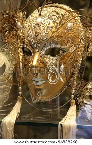 A beautiful carnival mask behind a glass window - stock photo