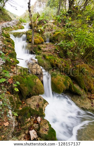 A beautiful cascade next to the path in Plitvice national park, an UNESCO world heritage site, in Croatia