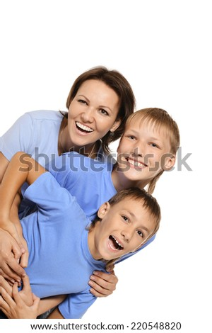 A beautiful Caucasian mother with the sons of fooling around on a white background