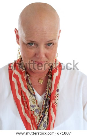 A beautiful chemotherapy patient with the courage to reveal her bare head.  Fourth in a sequence. - stock photo