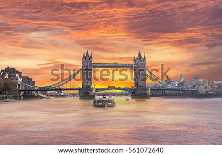 A Beautiful, Colorful Sunrise behind the Tower Bridge in England from Thames River