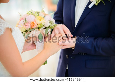 A beautiful colorful wedding bouquet for the bride. Details for marriage, and for spouses - stock photo