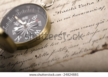A beautiful compass on an old letter