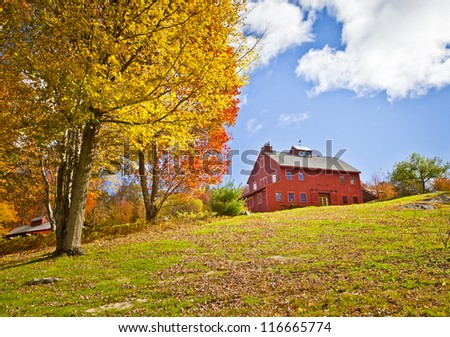 A beautiful country building in the fall - stock photo
