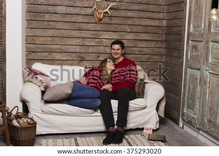 a beautiful couple. a love story, celebrating the New Year's holiday, Christmas and Valentine's Day. In the background christmas attributes: Christmas tree and gifts.