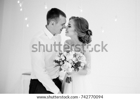 A beautiful couple. Bride and groom. They look at each other.  black and white photo