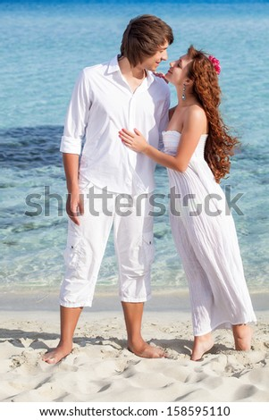 A beautiful couple on the beach - stock photo