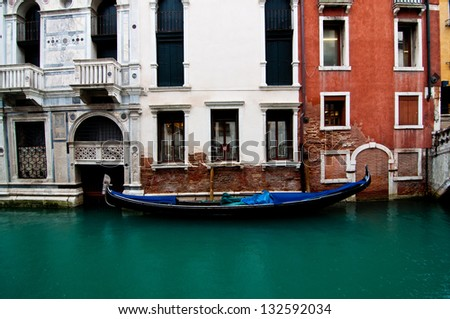 A beautiful decorated gondola boat parking on a canal in Venice, Italy