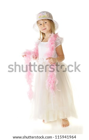 A beautiful elementary girl all dressed up in white with a long pink boa.  On a white background.
