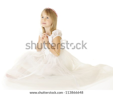 A beautiful elementary girl sitting in a flowing, white dress looking heavenward with her hands clasped.  She wears a wreath of pink pearls on her head.  On a white background.
